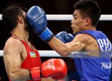 Фотогалерея боя Шахобиддина Зоирова с филиппинским боксером