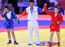 Uzbekistan's Nodira Gulova awarded a bronze medal in women's sambo at the 18th Asian Games