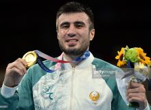 Photo Gallery. Bakhodir Jalolov adds Olympic gold to his 2019 world champion crown