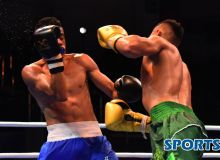Photo Gallery. Shunkor Abdurasulov shocks his Colombian opponent