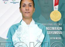 Uzbekistan's Nozimakhon Kayumova takes a golad medal in women's javelin F13