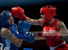 Photo Gallery. Raykhona Kodirova gives the way to Beatriz Ferrera in the quarterfinals