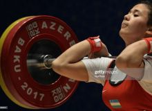 Uzbekistan's Muattar Nabieva clears 98kg to reset the Olympic record in snatch