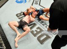 """UFC 251"". Амирхани рақибини бўғиш усули билан енгди"