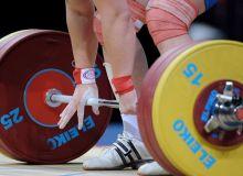 Dolera Davronova claim the third gold medal for Uzbekistan at the IWF Junior World Championships 2018