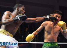 Photo Gallery. Andy Cruz defeats Ikboljon Kholdorov