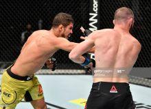 """UFC 251"". М-1 собиқ чемпиони фаолиятида илк бор мағлуб бўлди"
