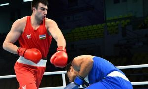Bakhodir Jalolov overwhelms Australia's Justis Huni to pick up the third gold medal for Uzbekistan