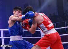 Photo Gallery. Mironshokh Ibragimov controls the tough flyweight contest against Shakhzod Muzaffarov