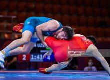 Uzbekistan's Javrail Shapiev suffers a defeat to Hassan Yazdanicharati of Iran in the wrestling opening contest