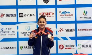 Uzbekistan's Muattar Nabieva wins a bronze medal at the IWF Weightlifting World Cup