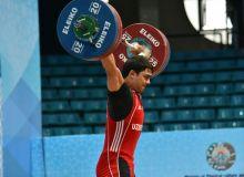 Akbar Djuraev earns a silver medal at the IWF Junior World Championships 2018