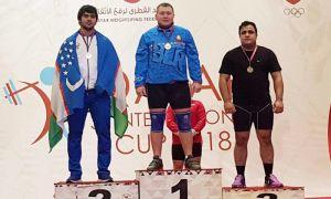 Акбар Жураев завоевал три медали в рамках рейтингового турнира по тяжелой атлетике