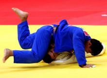Uzbekistan's Bekmurod Oltiboev earns a bronze medal in the 18th Asian Games