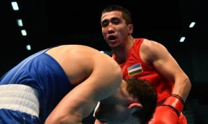 Mirazizbek Mirzakhalilov claims a gold medal at Asian & Oceanian Olympic Boxing Qualifying Event