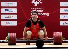 Uzbekistan's weightlifter Rustam Djangabaev claims a bronze medal