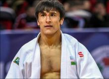 Uzbekistan's Shakhram Akhadov beats Tal Flicker of Israel for a bronze medal in Budapest Grand Prix