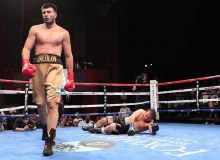 Uzbekistan's Bakhodir Jalolov extends his perfect record scoring a stoppage win over American Willie Harvey