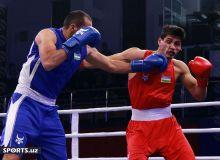 Photo Gallery. Saidjamshid Jafarov downs Odiljon Aslonov to win the elite title