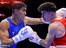 Muydinkhujaev outboxes McKeever in an opening bout for Uzbekistan national team