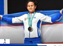 «Они будут защищать честь страны в Токио»: первая узбекская спортсменка, которая стала призёром ЧМ по тяжёлой атлетике — Муаттар Набиева