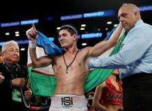 Shohjahon Ergashev enjoys a 4th round KO win over Abdiel Ramirez