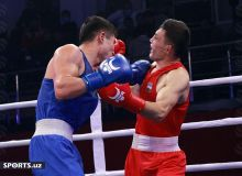Photo Gallery. Bobo-Usmon Baturov claims a gold medal beating Javlonbek Yuldashev