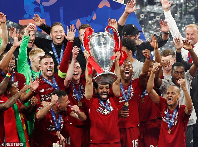 14246948-7094761-Liverpool_forward_Mohamed_Salah_lifts_the_Champions_League_troph-a-8_1559428843954