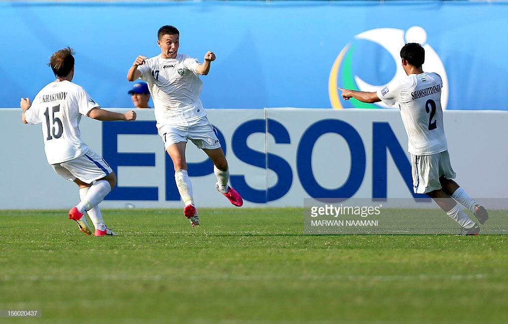 uzbekistans-igor-sergeev-celebrates-after-scoring-a-goal-during-their-picture-id156020437