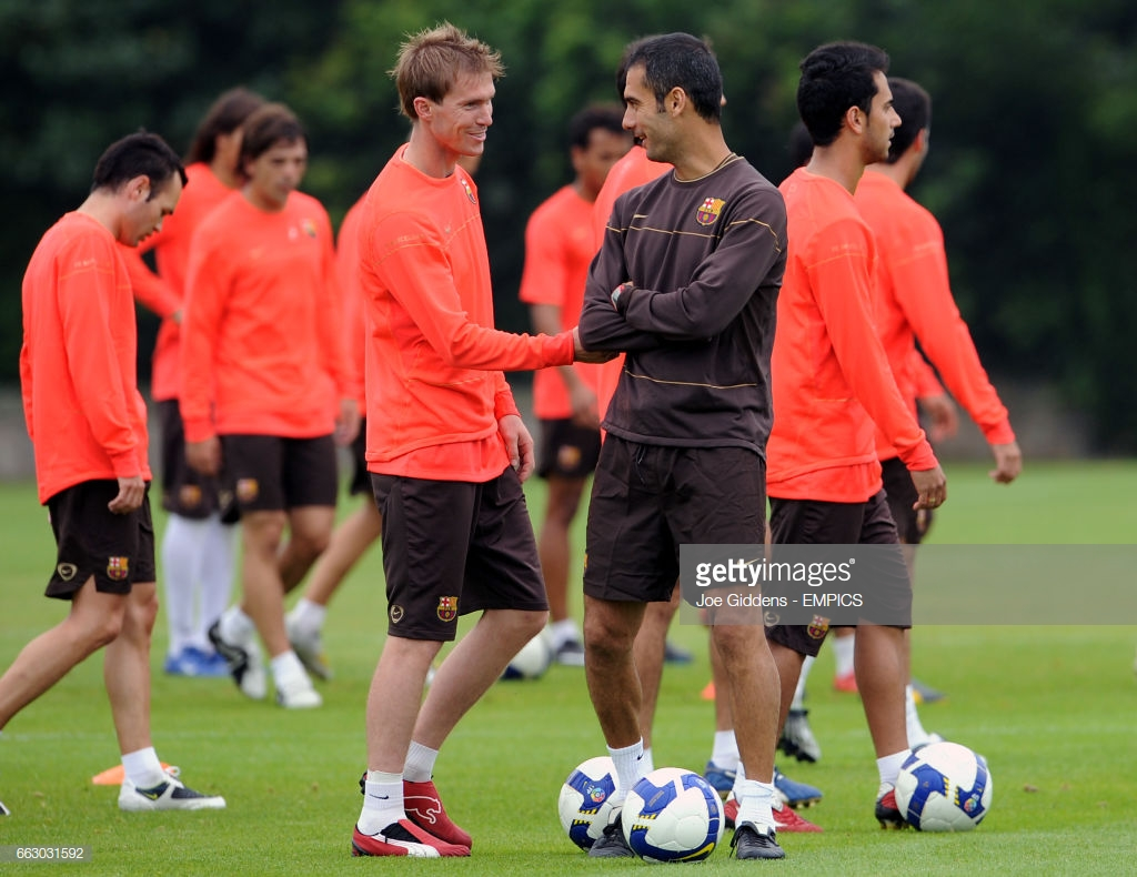 barcelonas-aleksandr-hleb-and-manager-josep-pep-guardiola-picture-id663031592